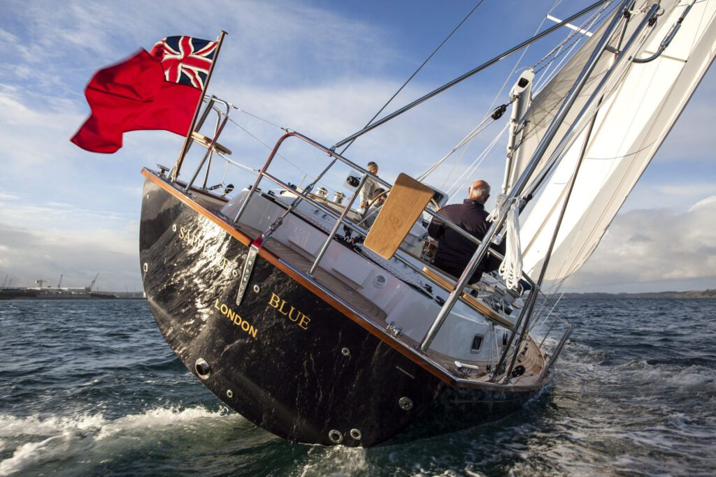 Rustler 44 sailing, stern view