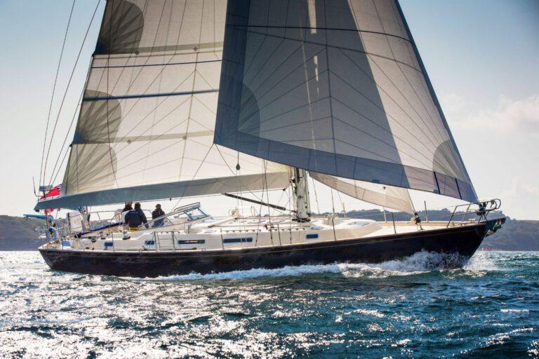 Rustler 57 sailing, bright sunshine