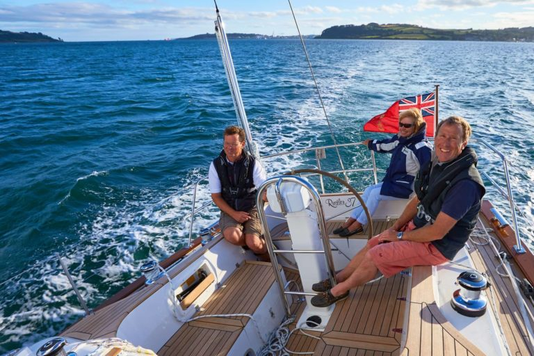 Rustler 37 - Tim Stevenson (r) on board Andrillot II with his wife, Mary, and Rustler's Adrian Jones